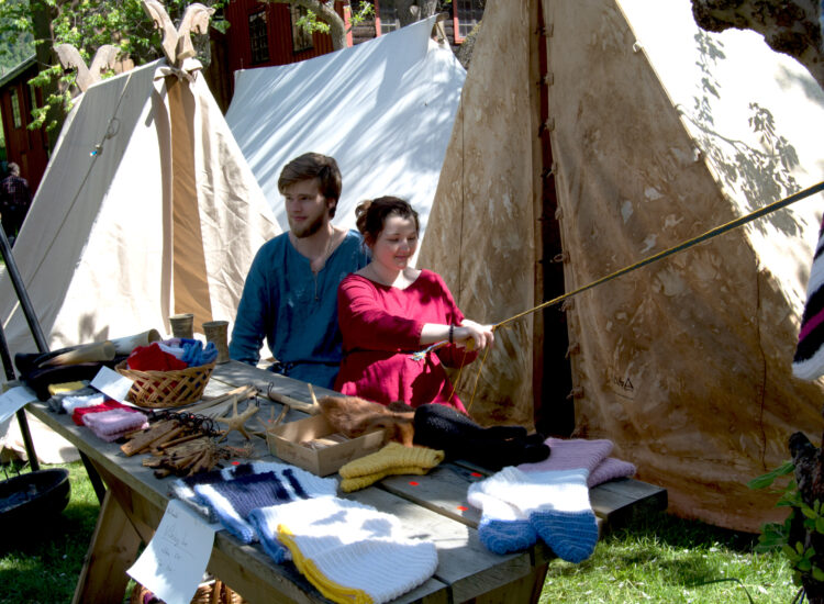 Vikings at their tents working